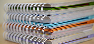 A stack of spiral-bound books