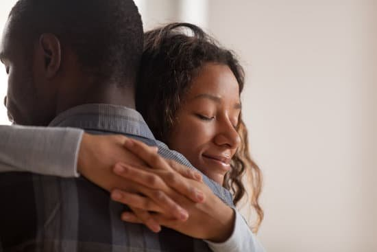 Emotional Setback: Woman smiling with eyes closed hugging a man